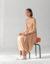 Moon Choiのドレス、Christian Wijnantsのミュール、CassinaのLC8チェア(シャルロット・ペリアンのデザイン)